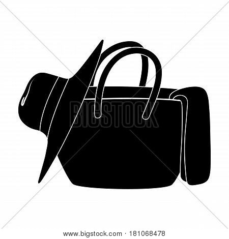 Beach bag with hat.Summer rest single icon in black style vector symbol stock web illustration.