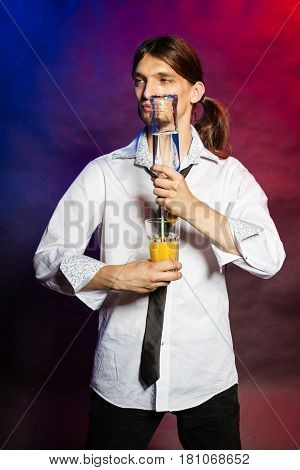 Partying Barman Makes Cocktail.