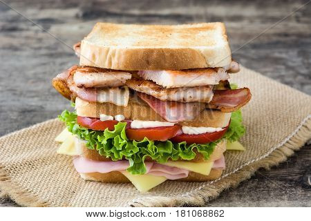 Delicious club sandwich on wooden table background