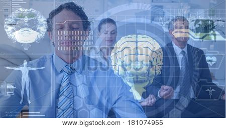 Digital composite of Double exposure of brains and business people meditating