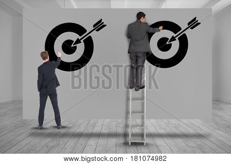 Digital composite of Digital composite image of business people setting targets on wall