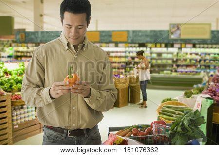 Asian man grocery shopping