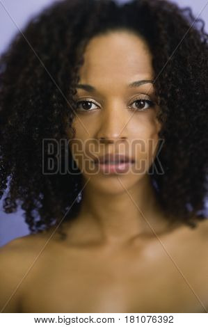 African woman with bare shoulders