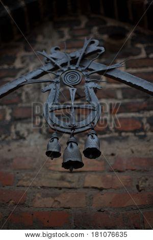 Old black wrought iron bells in old Lubart castle Lutsk Ukraine