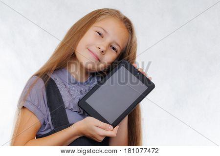 A teenager girl enjoys a new tablet