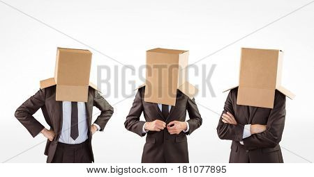 Digital composite of Multiple image of businessmen with cardboard boxes covering head