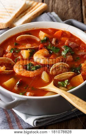 Manhattan Clam Chowder Soup With Shellfish And Bacon Close-up On A In A Pan. Vertical