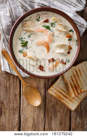 American Cuisine: New England Clam Chowder Soup Closeup. Vertical Top View