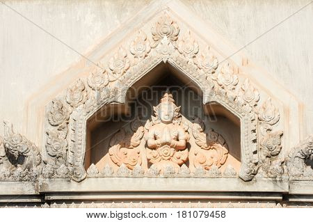 Statue on a detail of Patuxai Arch in Vientiane on Laos