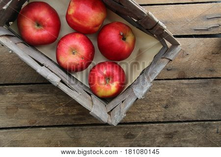 Wooden crate box full of fresh apples on table