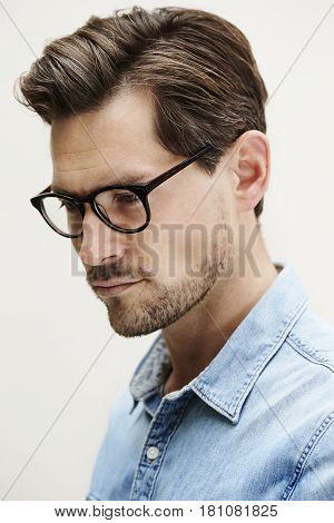 Mid adult man in spectacles looking away
