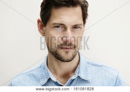 Portrait of handsome man with goatee daylight portrait