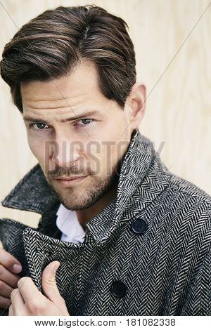 Portrait of posing man in coat outdoor portrait