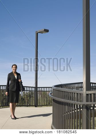 Native American businesswoman standing outdoors