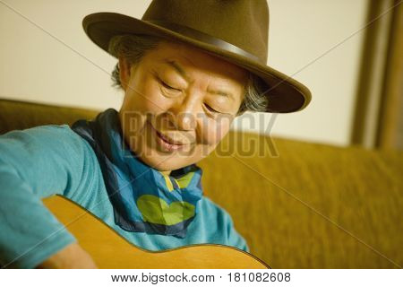 Japanese woman playing guitar