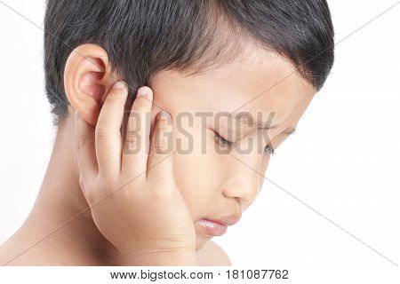 Tinnitus. Closeup up side profile sick boy having ear pain touching his painful head.