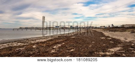 MALMO SWEDEN - MARCH 12 2017: Malmo West harbour area with Turning Torso building is one of largest residential construction projects in this Swedish town panoramic view