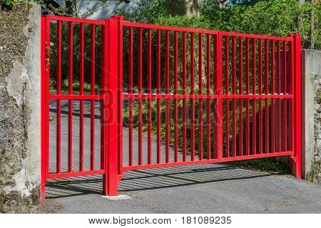 red gate at the entrance to the house