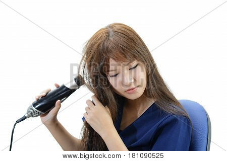Hair Care. Woman Drying Beautiful Long Straight Hair Using Dryer. Portrait Of Attractive Girl Model