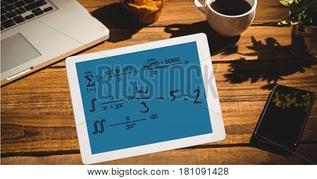 Digital composite of Math equation of tablet PC's screen at outdoor cafe
