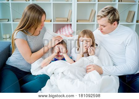 Family is having common alergy, wiping noses