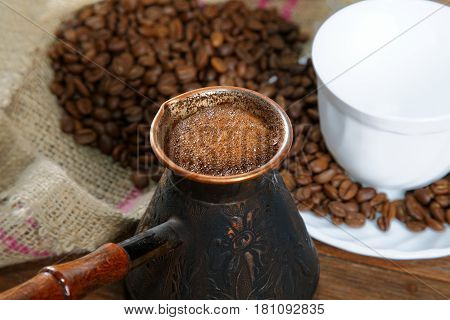 Turka With Coffee On The Table Next To Coffee Beans