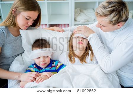 Family is ill and having common cold, wiping noses