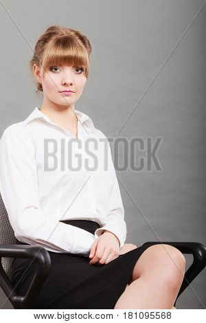 Portrait of elegant young businesswoman manager boss. Woman white collar worker wearing business shirt.