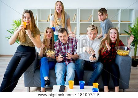 Group of friends playing a playstation game