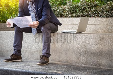Looking For The Right Document. Confident Young Business Man In Formal Wear Taking The Documents Out