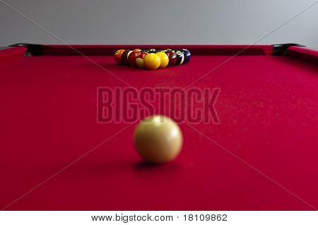 Balls on a red pool table