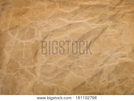 old brown background, crumpled and spotted paper