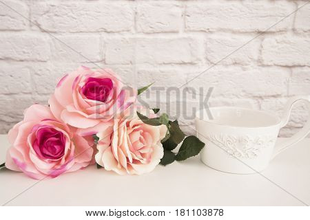 Bouquet Of Roses On A White Desk, A Large Cup Of Coffee In Front Angel, Romantic Floral Frame Backgr