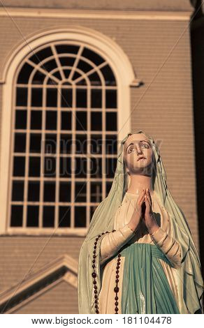 Religious statue in front of a Church in  Church Point Nova Scotia
