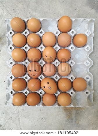 Dozen of chicken egg for cooking breakfast in the egg storage tray with blur background Easter egg for hiding Easter egg surprise happy and smile face Top view