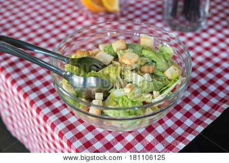 cesare salad in a glass bowl. Brunch in a restaurant.