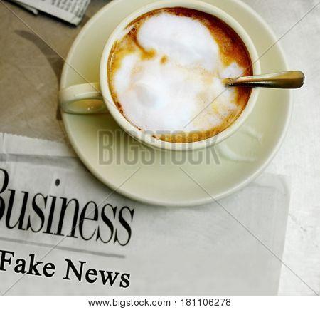 Fake News newspaper headline with morning coffee