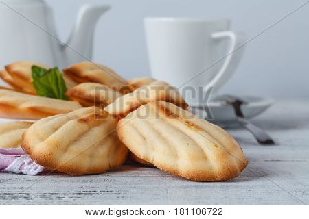 The French cookies Madeleine with mint and coffee