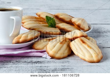 Festive Madeleines Baked With And Served On A Wooden Board