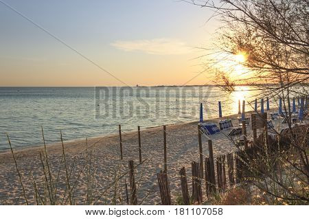 The most beautiful sandy beaches of Apulia.Salento coast: shoreline at sunset.Porto Cesareo skyline.ITALY (Lecce) The sandy coastline is characterized by dunes covered with Mediterranean maquis.