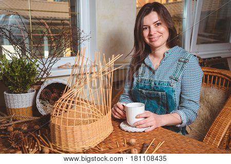 pretty woman making basktes indoor, handmade business