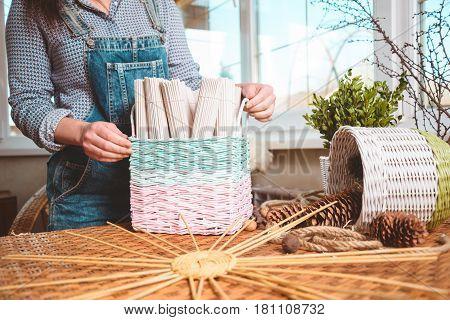 woman holds basket with sets for basketmaker close up
