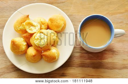 vanilla Choux Cream on dish and coffee cup