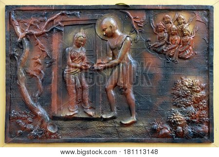 KOLKATA,INDIA - FEBRUARY 09, 2016: Accepting aims from Chandanbala for breaking fasts of five months and twenty five days with specific vows, bass relief on the wall of Jain Temple in Kolkata, India