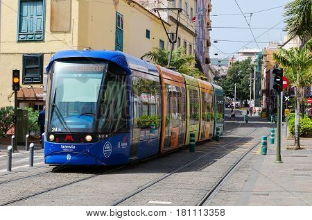 SANTA CRUZ DE TENERIFE, Canary Islands, SPAIN. March 1, 2017. Colorful Metro or tram tranvia of Tenerife connects the important places of the metropolitan area of Tenerife. This tramway network consists two lines.