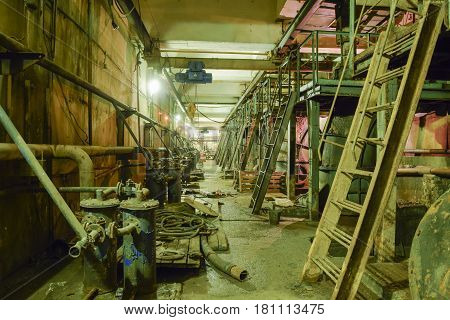 Basement Of A Water Pumping Station. Abandoned Post-apocalyptic