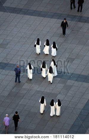 ZAGREB, CROATIA - MAY 31: Nuns crossing Ban Jelacic Square in Zagreb, Croatia on May 31, 2015.