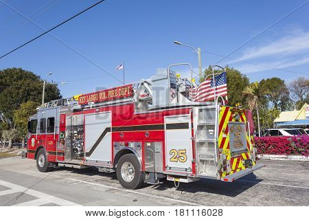 Key Largo Fl USA - March 16 2017: Fire engine of the Key Largo fire department parked on on the side of the road. Florida United States