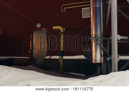 Red building. Yellow Gas Pipe. Entrance to the building.