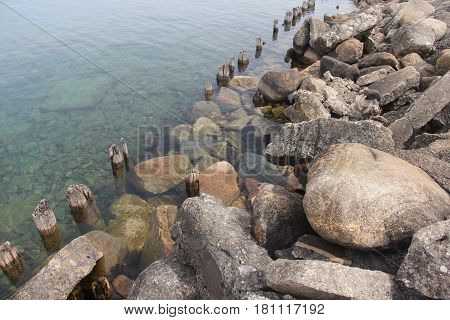 Rocks and boulders line the shoreline of Lake Michigan